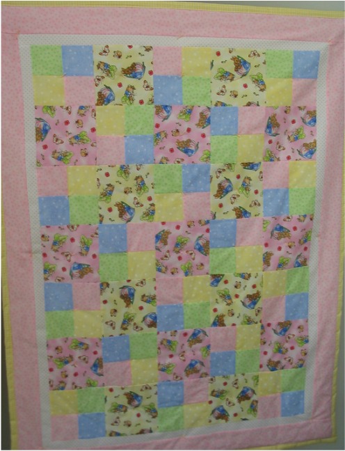 Bunny quilts the quilt below is entitled spring has sprung it is made from easter and spring themed fabrics with a pink backing it is 38 x 44 and is suitable as a negle Choice Image